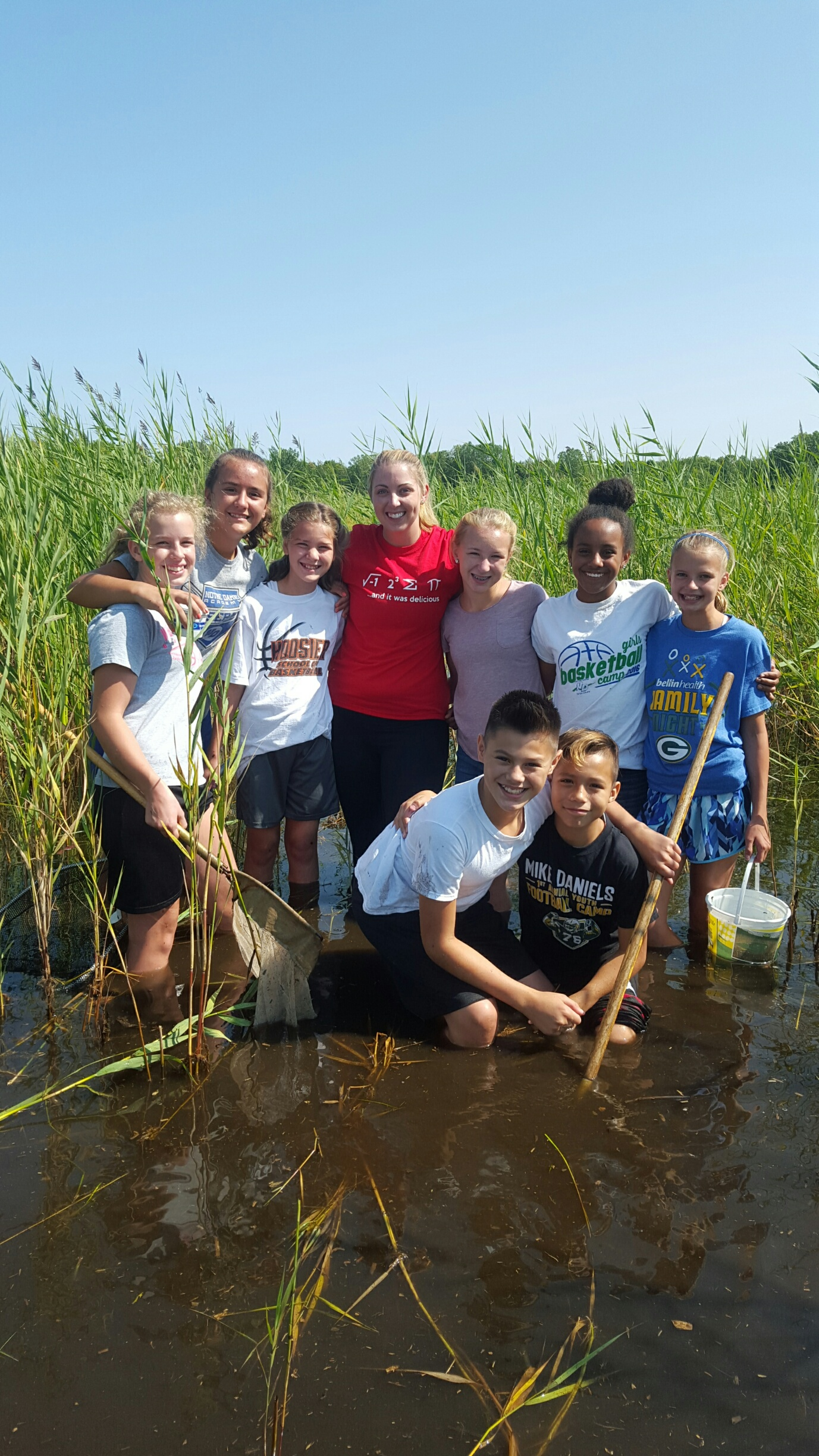 Group of children exploring a pond