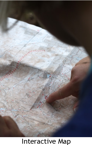 Photo of Map with Finger Pointing