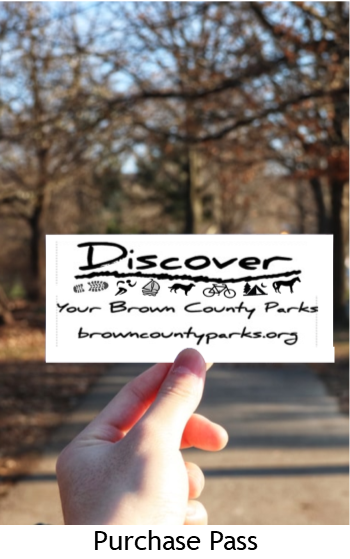 Discover your Brown County Parks card being held outdoors