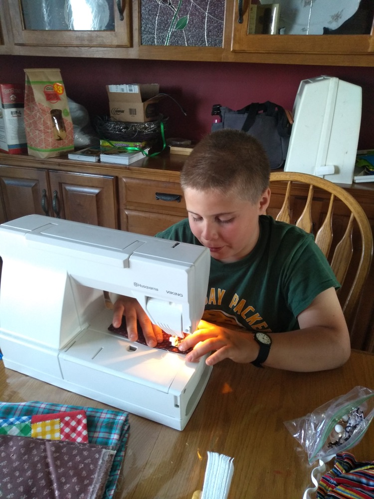 Boy Sewing